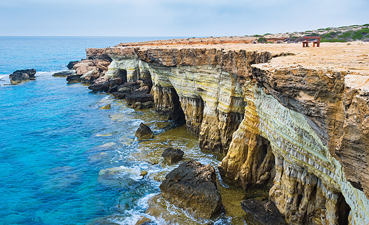 The best time to discover the rocky coast is the early morning the weather is cloudy and not very hot Cavo Greco Ayia Napa Cyprus.